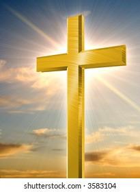 golden cross in front of orange sunset