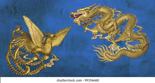 golden dragon and golden phoenix on blue stain wall background