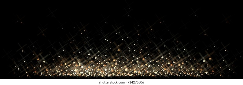 Golden dust isolated on black floor. Precious glitter pattern. Sparkles twinkle on background. Festive glisten texture.