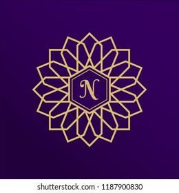 Golden flower logo design with letter N. New arabic geometric logotype. Luxury gold emblem, brand or company name. Round floral icon for jewelry salon, boutique, cosmetics store, shop.