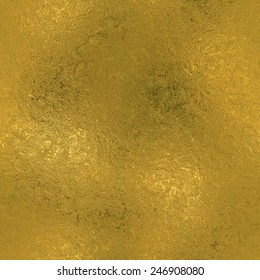 Golden Foil luxury seamless and tileable background texture. Glittering holiday wrinkled gold background and shiny bright metal surface backdrop.