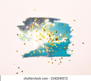 Golden glitter on abstract blue and gold watercolor splashes in vintage nostalgic colors.
