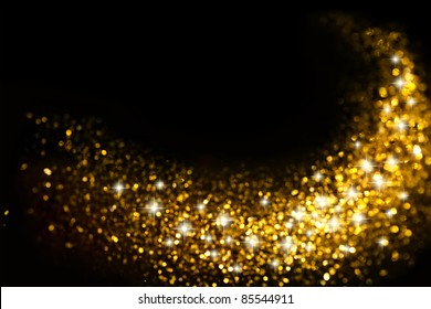 Golden Glitter Trail with Stars Background with space for your text