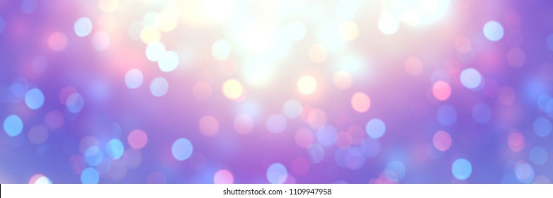 Golden glow and festive shining confetti on violet blue yellow iridescent banner. Empty background. Defocus glitter template. Abstract bokeh pattern. Blurry texture. Magical winter holiday style.