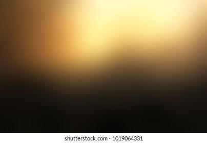 Golden glow on black empty background. Elite blurred texture. Luxury abstract illustration. Exclusive defocused image.