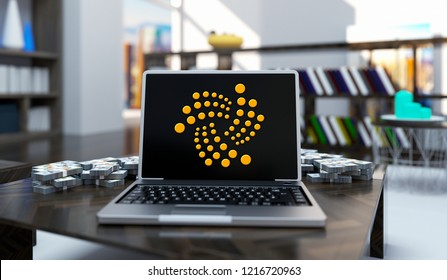 Golden Iota Coin Logo Write Laptop On Living Room Background. 3D Illustration Of Gold Iota Coin Sing.