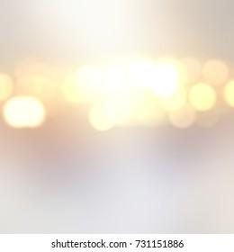 Golden lights empty background. Silver blurred texture. Bokeh defocused background. Festive abstract background. Glare abstract texture.