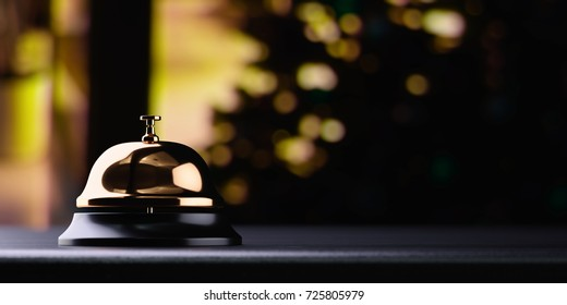 Golden reception bell on black table with shallow depth of field black background. Service concept. 3d rendering illustration