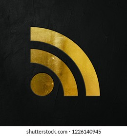 Golden RSS Feed Icon Write On The Dark Wall Background. Golden RSS Feed Icon. 3D İllustration.