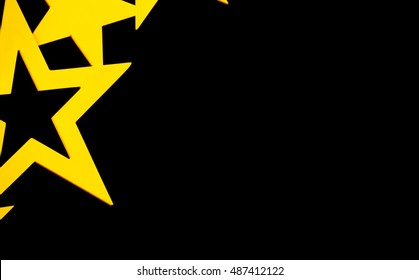 Golden stars on black background with space for text