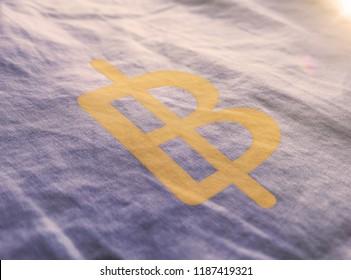 Golden Thailand Baht Money 3D Illustration Symbol Write On The Fabric. Thailand Baht Money Logo On The Fabric. Golden Thailand Baht Money Logo. 3D Rendering.