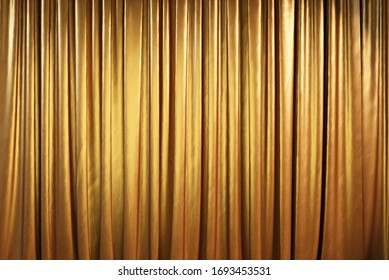 Golden theater curtains or drapes. 3d illustration.