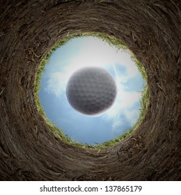 Golf ball falling in cup.