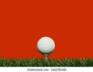 Golf ball on tee placed in the grass isolated on red background 3DCG illustration
