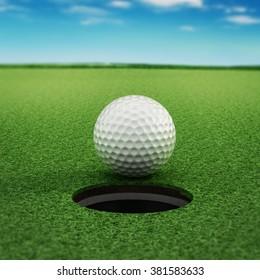 Golf ball standing near the hole on green grass