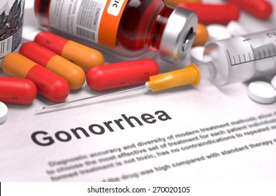 Gonorrhea - Printed Diagnosis with Blurred Text. On Background of Medicaments Composition - Red Pills, Injections and Syringe.