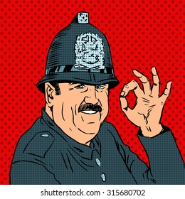 Good English policeman in uniform and helmet shows gesture OK. Positive police