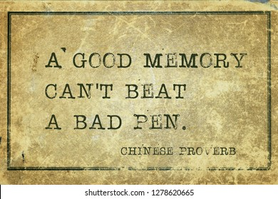 A good memory can't beat a bad pen - ancient Chinese proverb printed on grunge vintage cardboard