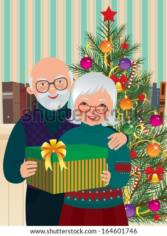 grandma and grandpa with christmas present under the christmas tree standelderly couple celebrating christmas - Grandpa For Christmas