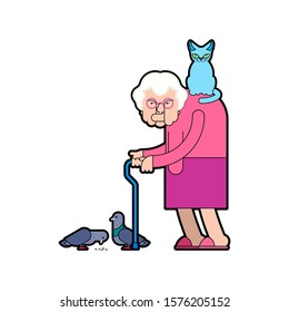 Grandmother feeds pigeons. Grandma and cat. Good Old lady and dove.