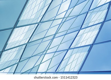 Graphic design of business architecture. Hi-tech modern office building. Abstract framed glass structures. Fragment of transparent facade wall, ceiling or roof with metal framework and sky reflection