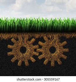Grassroots support or grass root concept and local community action symbol as a political social organization symbol with roots shaped as gears as an icon of lower class society help.