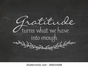 gratitude quote on a dusty black chalkboard