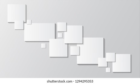 The gray background in the foreground is a white square paper in various sizes, beautifully stacked together, with a depth of field.