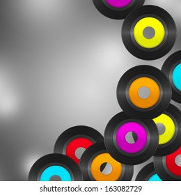 Gray background with many flying vinyl records with colorful empty labels