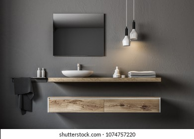 Gray bathroom sink standing on a wooden shelf. A square mirror hanging on a gray wall. 3d rendering
