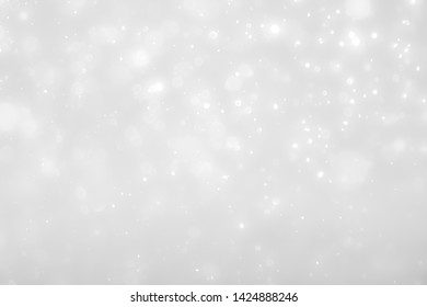 gray bokeh White and Silver lights on bokeh abstract background.