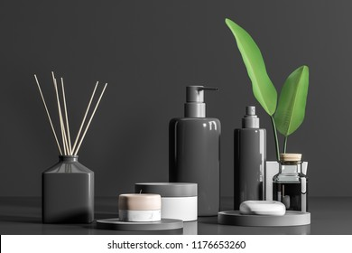 Gray bottles with soap and spa products in white mock up containers. Aroma sticks on white table. Grey wall background. Relaxation and self care concept. 3d rendering