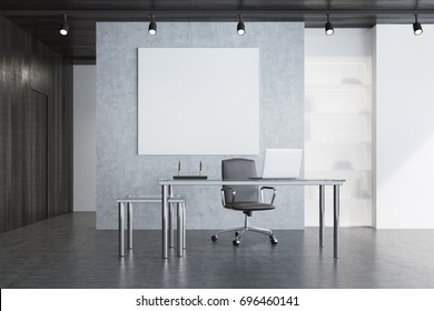 Gray CEO office interior with a modern table, a white laptop standing on it, an armchair and built in bookcase. A square poster is hanging on a wall. 3d rendering, mock up