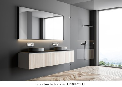 Gray double sink standing on a wooden countertop attached to a gray wall. A long horizontal mirror hanging above it. A side view. 3d rendering mock up