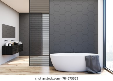 Gray hexagon tile bathroom interior with a double sink standing on a black shelf and a white bathtub. 3d rendering mock up