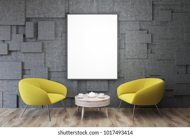 Gray living room interior with yellow armchairs standing near a round coffee table with and a framed vertical poster hanging above it. 3d rendering mock up