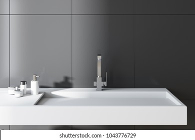 Gray wall bathroom interior with a long white sink and a chair with towels. A close up. 3d rendering.