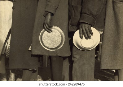 The Great Depression. African Americans in the lineup for food in the camp for flood refugees, Forrest City, Arkansas. Walker Evans photo, 1937.
