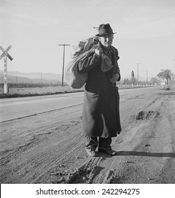The Great Depression. Itinerant worker, traveling by foot, looking for work in mines, lumber camps, or farms. Industrial Workers of the World (IWW). Photo by Dorothea Lange, 1938.