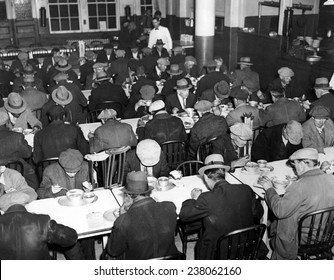 Great Depression Unemployed and homeless men eating at Municipal Lodging House (25th Street & East River) New York City