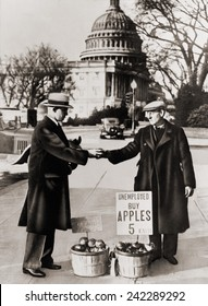 The Great Depression. Unemployed man sells apples near the Capitol in Washington D.C. As the Great Depression deepened in 1930, obtained apples from the International Apple Shippers Association. 1930