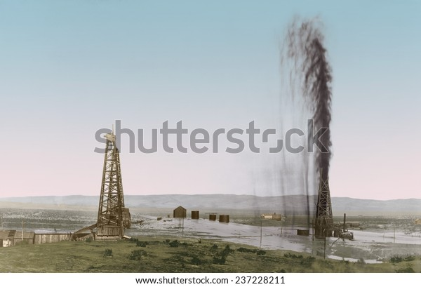 Great gusher in a California oil field floods the surrounding scrub land, 1910 photo with modern digital color.