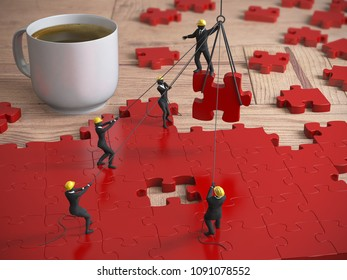 A great red jigsaw puzzle being built by a team of miniature people on a wood table next to a coffee cup as 3d rendering.