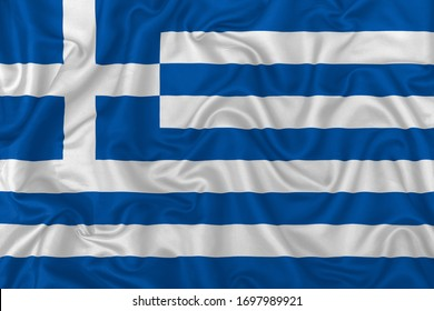 Greece country flag on wavy silk textile fabric background.