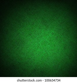 green background or green paper with bright spotlight on black background texture, for Christmas card or Christmas background or for St. Patrick's Day background, with vintage grunge texture