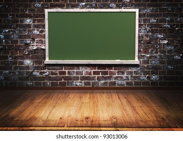 green blackboard with wooden frame on brick wall