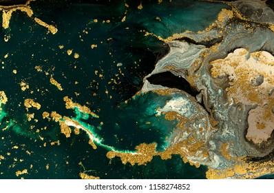 Green and blue marble abstract acrylic background. Marbling artwork texture. Agate ripple pattern. Gold powder.