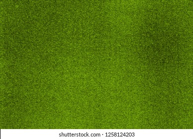 Green bright fresh background, reminiscent of the natural organic texture of the grass field on top