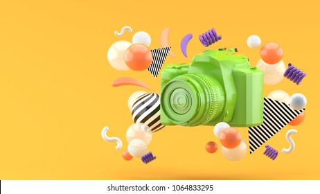 Green camera surrounded by colorful balls on an orange background.-3d render.