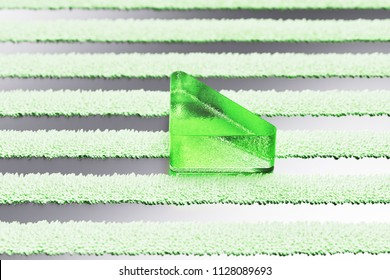 Green Caret Down Icon on the Silver Stripes Background. 3D Illustration of Green Arrow, Caret, Down, Download Icon Set With Striped Pattern.